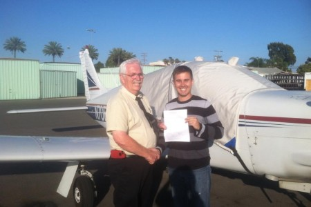 DPE Pat Carey with Zachary Walters after a successful commercial check ride in N70EF